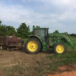 Close up of tractor with trailer of planting supplies